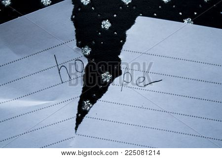word of hope on a torn sheet