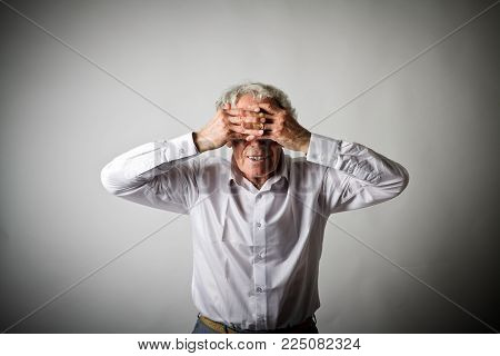 Frustrated. Old Man In White Is Suffering From Headache. Expressions, Feelings And Moods.
