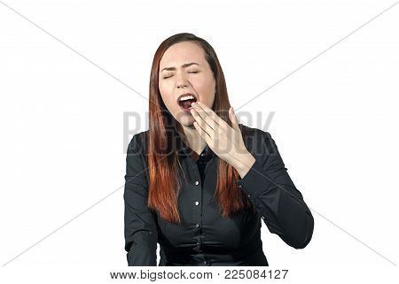 woman on a white background yawns covering her mouth with her hand