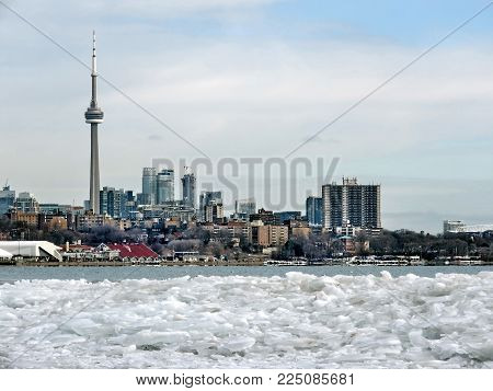 Ice and panorama of Downtown from Humber Bay of the Lake Ontario in Toronto, Canada, January 25, 2018