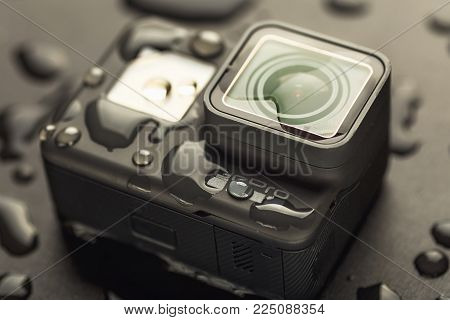 Russia, Moscow - February 3, 2018: GoPro HERO 6 action camera in water drops on black background. Waterproof camera body and modern high-definition video formats support