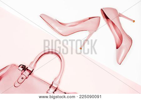 Art Minimal fashion concept. pink nude female shoes on white background. Flat lay, top view trendy fashion feminine background.