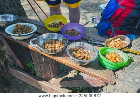 Delicious porridge with cereals, mountain hiking meals