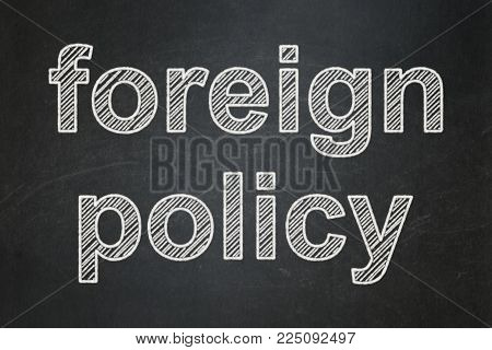 Politics concept: text Foreign Policy on Black chalkboard background