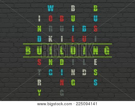 Construction concept: Painted green word Building in solving Crossword Puzzle