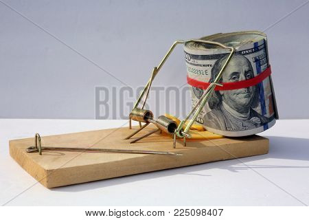 us money rolled up with a rubber band isolated on white. the most popular money.