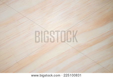 White wooden background. Pale yellow natural wood closeup. Light timber ornament. Clean lumber macrophoto. Maple or pine tree board for floor. Wooden table with tree trunk pattern. Warm timber texture