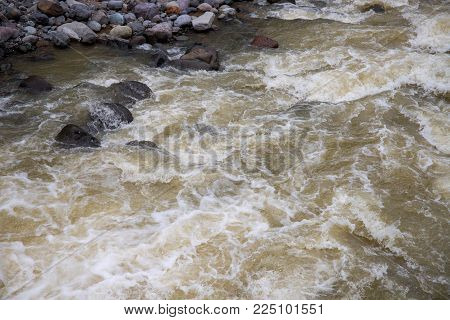 Mountain river with fast water current. River water photo texture. Green river in tropics wallpaper. Still rippled water of fresh spring in forest. Rippled river texture. Natural water current closeup