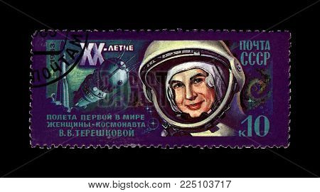 USSR - CIRCA 1983: canceled stamp printed in USSR (Soviet Union) shows soviet astronaut Valentina Tereshkova, 1st woman in the space, rocket shuttle, 20th anniversary of the space flight, circa 1983. vintage post stamp on black background.