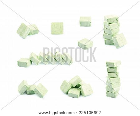 Pile of fruit flavoured chewing candies isolated over the white background, set of multiple different foreshortenings