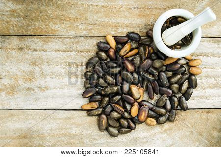 Kidney beans (Also named as Phasecolus vulgaris bean, or red beans) isolated on wood background