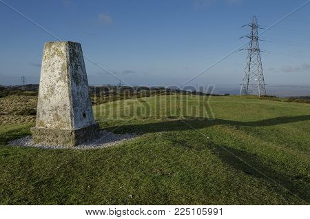 Landscape views from the summit of Halkyn Mountain with the trig point being prominent in the view. With copy space