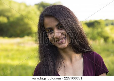 Beautiful laughing young woman, outdoor shooting in summer
