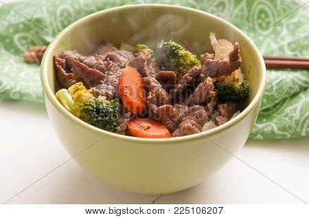 beef stir fry with fresh vegetables over white rice