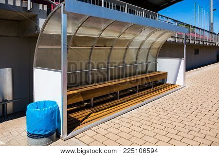 Empty Trainer Bench in a smal stadium in summer
