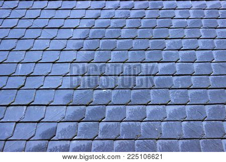 Wet Slate Roof as Background. Shot Outdoor.