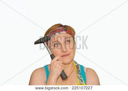 a woman with a hammer, with a wistful glance , the concept of international women's day