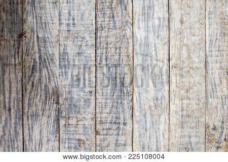 Bright grungy grey wooden floor photo background. Rustic wood plank closeup. Silver wooden background. Boho design. Timber texture. Shabby chic banner template. Obsolete timber table. Wooden flat lay