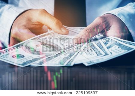 Dollar bills and finance and banking on digital stock market financial exchange