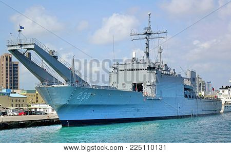 KAOHSIUNG, TAIWAN -- AUGUST 5, 2017: A large naval ship is anchored in Kaohsiung port across Chijin Island.