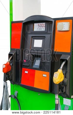 Two colors of fuel nozzle at gas station isolated on white background