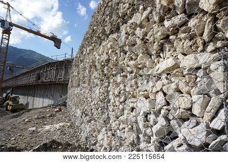 Gabion or wire box which filled with rocks use to be retaining wall in construction site