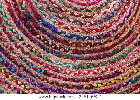 Close Up Of Part Of A Colorful Rag Rug With Braided Coils In Semicircles.