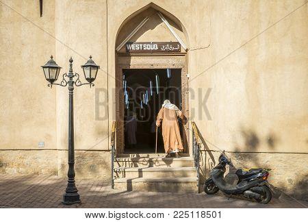 Nizwa, Oman, Febrary 2nd, 2018: Old Omani Men Walking Into Souq