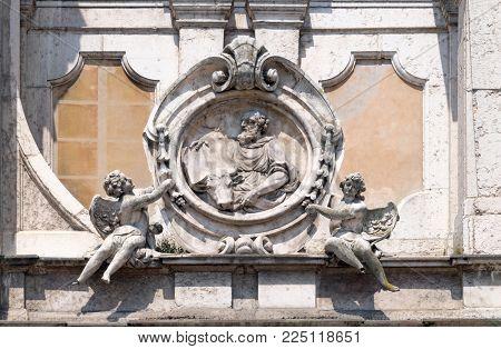 MANTUA, ITALY - JUNE 04: Saint Luke the Evangelist, statue on facade of the Mantua Cathedral dedicated to Saint Peter, Mantua, Italy on June 04, 2017.