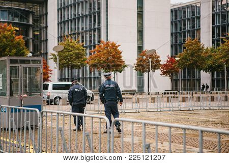 Berlin, October 2, 2017: Two Policemen Are Patrolling. Police Presence On The Streets Of The City. P