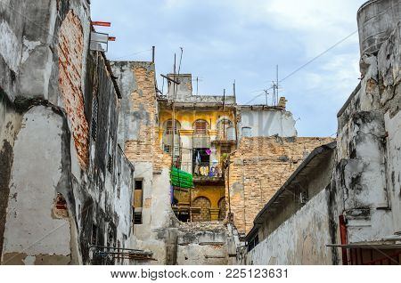 The human dwelling inside the dilapidated, half ruins multi-storey stone buildings at day time