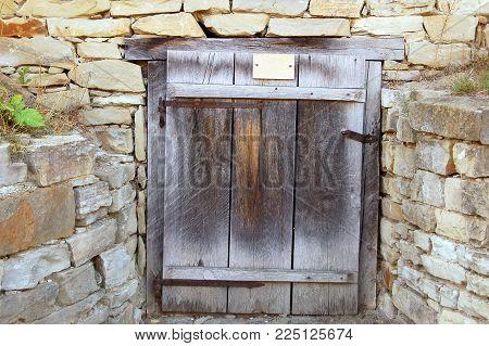 Ancient rustic wooden barn door in Ukraine