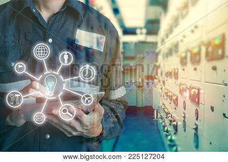 Industrial innovation technology and industry 4.0 concept. Double exposure of engineer man using tablet with digital icon tools for deverlop business concept.