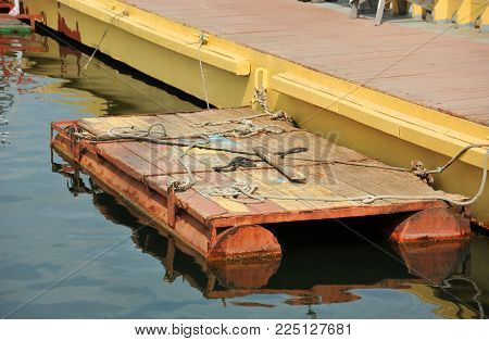 Old rusty pontoon and pier in sea port