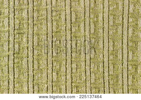 Knitted background. Knitting Pattern. Knitted texture. A sample of knitting.