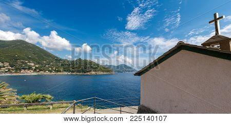 Beach And Coast Of The Village Of Bonassola And The Church Of Madonnina Della Punta. La Spezia, Ligu