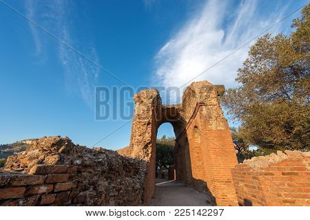 Detail of the ancient Greek Roman theater at sunset in Taormina town, Messina, Sicily island, Italy (II century AD)