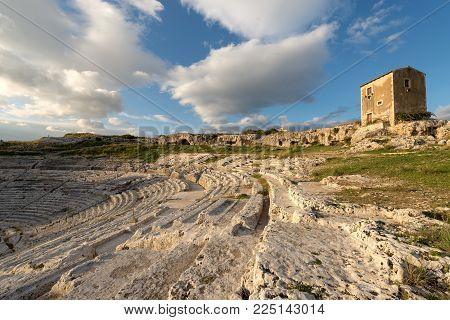 Ancient Greek Roman Theater At Sunset In Syracuse City (siracusa), Sicily Island, Italy, Europe (v C