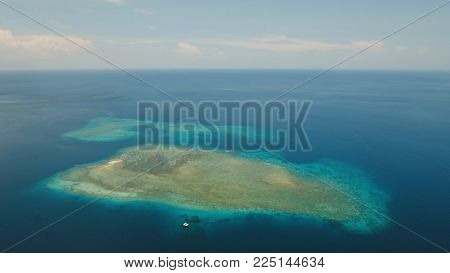 Aerial view coral reef, atoll with turquoise water in the sea.Tropical atoll, coral reef in ocean waters. Travel concept.