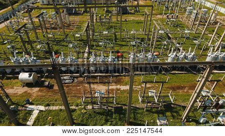Aerial view Power plant, transformation station, cables and wires. High voltage electric power substation. Electrical power transformer in high voltage substation,