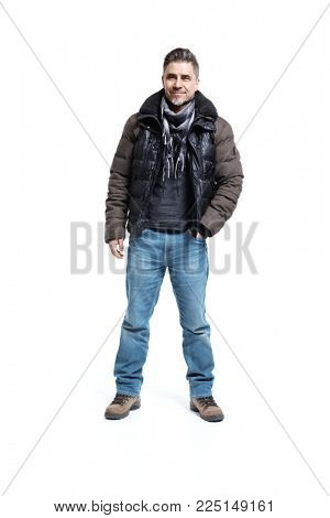 Happy older white man in casual coat and jeans isolated on white. Full-length portrait.