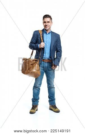 Happy older white man in business casual jacket and jeans isolated on white holding leather bag. Full-length portrait.