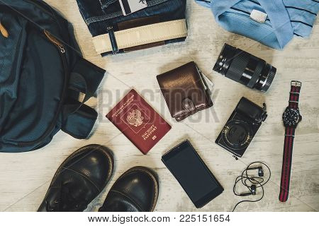 A Set Of Accessories For Travel On A Wooden Background. Flat Lay