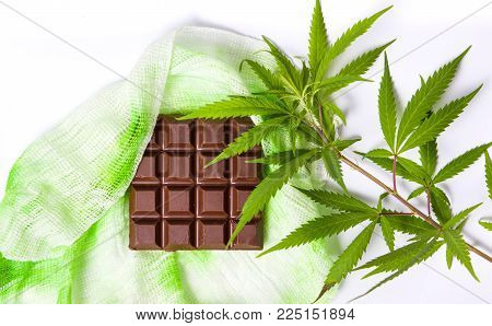 Chocolate block with marijuana leafs top view