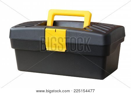 Closed tool box isolated on white background. Black plastic box with a yellow handle and clasp.