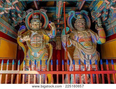 Wooden Korean Guardian Sculptures before entrance in Bulguksa Temple