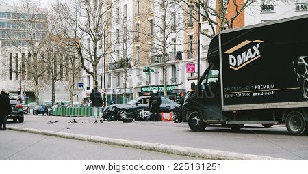 PARIS, FRANCE - JAN 30, 2018: Car accident on Paris street between luxury limousine Lancia Thesis and scooter moped transporting medical transfusion blood - rue de Courcelles