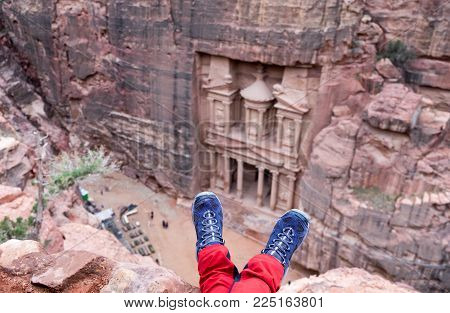 Girl Hiking Boots On Al-khazneh Background.  Al-khazneh (the Treasury) Is Beautiful Temple In The An