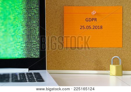 Board with the inscription DSGVO (General Data Protection Regulation) in English GDPR (General Data Protection Regulation) with a laptop and padlock for the introduction of the DSGVO in the EU on 25.05.2018
