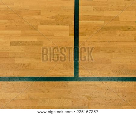 Black lines in hall playground. Worn out wooden floor of sports hall with colorful marking lines